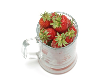 Strawberries in glass cup isolated on white    Stock Photo