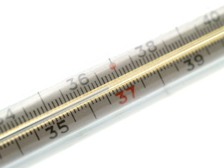 close-up mercury thermometer with a temperature 36.6