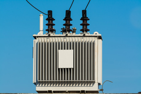 amp tower: Electric transformer against with blue sky