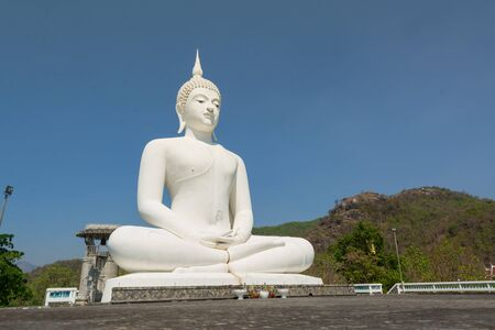 veneration: Big white buddha statue on the mountain ,temple in Tak province, Thailand.