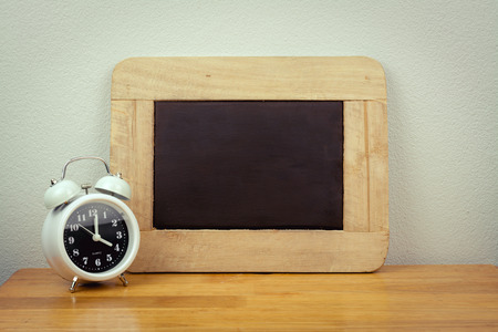 second breakfast: vintage alarm clock with text space on the wooden table