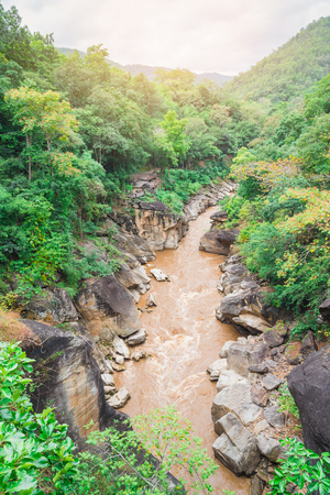 Beautiful nature with large rock hill mountain and river at Obluang National Park,Thailand.