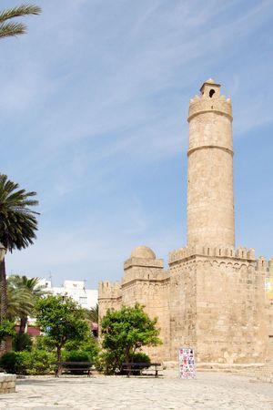 god walking: old arabian tower on plaza