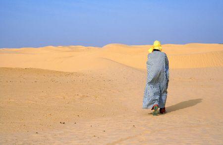 alone in sand of desert photo