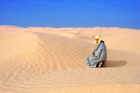 women in sand of desert photo