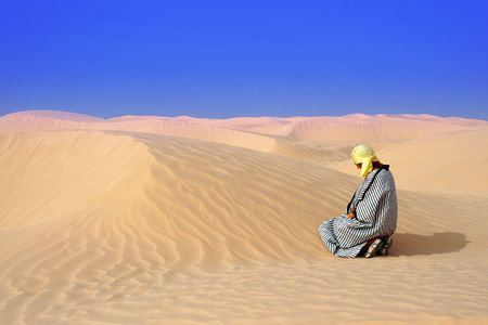 a;one in sand of desert photo