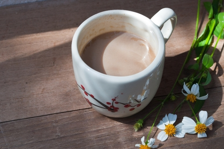 A cup of hot coffee, flowers romantic  photo