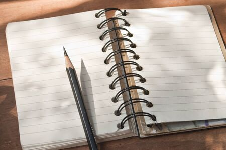 Notepad and pencil photo