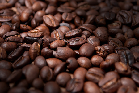 caffiene: Roasted whole, unground coffee beans. Stock Photo