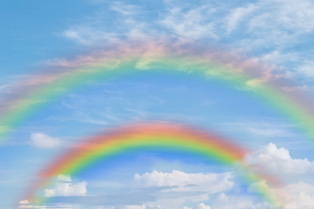 dubble rainbow in blue sky