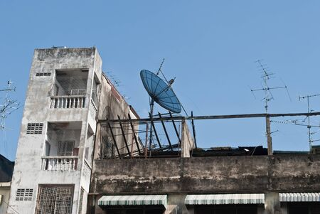 old buildings: old buildings tower and satellite dish Stock Photo