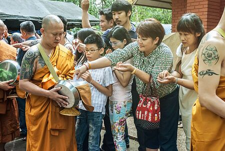 ordain: Chaingmai - July 25: People who believe merit the midst ordained, At Wat Umong In Buddhist Lent Day July 25, 2015 in Chaingmai, Thailand.