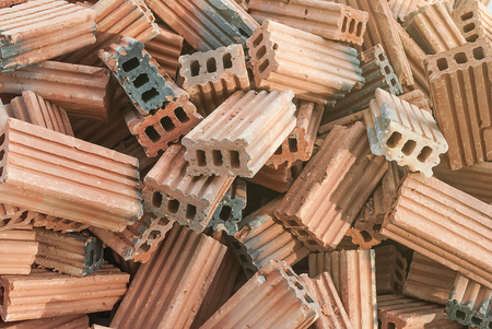 brick kiln: red brick stone for construction stacks, rough textured stones heap Stock Photo