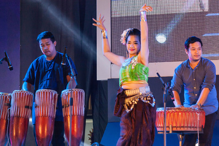 thai culture: Chiang Mai, Thailand - August 29-2015 : The show, she was dancing and jars pong lang the folk music of the Isan region of northeast Thailand, in event TOP THAI BRANDS at Chiang Mai, Thailand