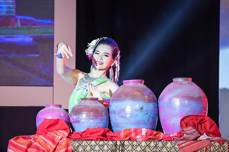 show folk: Chiang Mai, Thailand - August 29-2015 : The show, she was dancing and jars pong lang the folk music of the Isan region of northeast Thailand, in event TOP THAI BRANDS at Chiang Mai, Thailand