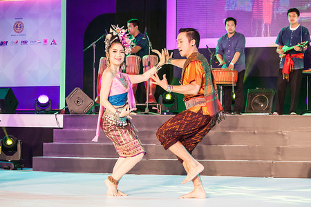 lang: Chiang Mai, Thailand - August 29-2015 : The show, she was dancing and jars pong lang the folk music of the Isan region of northeast Thailand, in event TOP THAI BRANDS at Chiang Mai, Thailand
