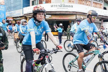simultaneous: Lamphun,Thailand - August 16, 2015 : Event Bike for mom  from Thailand, Bike for mom event respected to Queen Sirikit and make Thailands cyclists set record for worlds biggest bike ride goes into Guinness World Records. Editorial