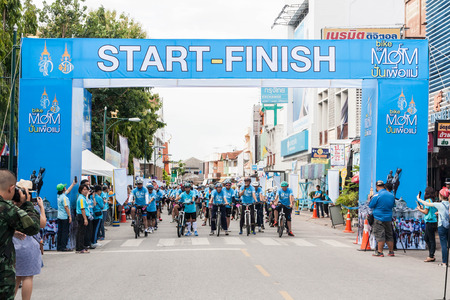 simultaneous: Lamphun,Thailand - August 16, 2015 : Event Bike for mom from Thailand, event respected to Queen Sirikit and thailands cyclists record for worlds biggest bike ride goes into guinness book