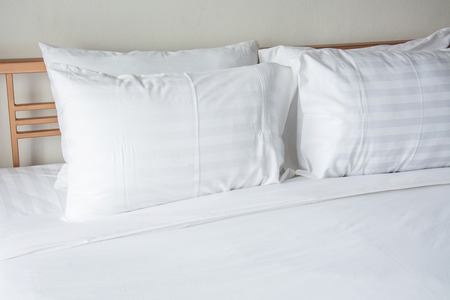 white blanket: white pillow on bed with white blanket in bedroom