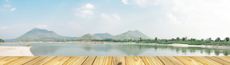khong river: Empty perspective old wooden over on Kangkudkhu Insel at Chiang Khan Insel large One of Thailand This area is a wide sandy beach and a stone-lined well rounded shiny hundreds of thousands of pieces, panorama view Stock Photo