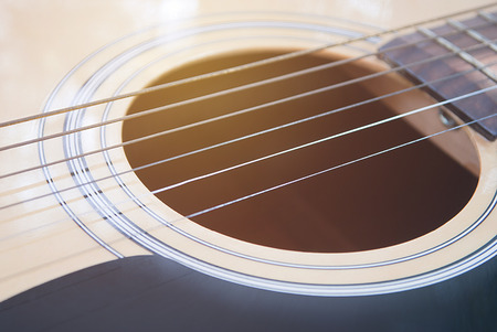 band bar: Close-up of acoustic guitar in vintage style