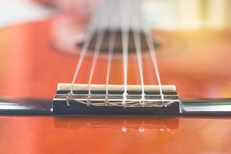 hook up: close-up of classical guitar bridge