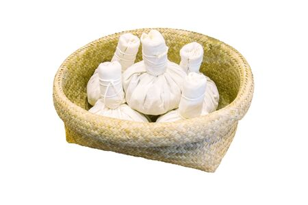 herbal compress for spa treatment in wicker baskets isolated white for background Stock Photo
