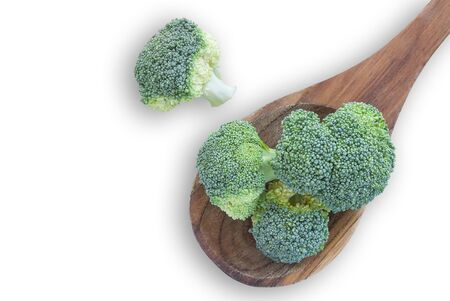 cruciferous: Fresh broccoli vegetable in wooden spoon isolated on white background