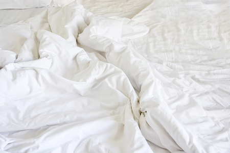 frowzy: wrinkle messy blanket in bedroom after waking up in the morning, from sleeping in a long night.
