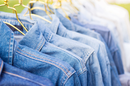 Jeans shirt sold in the market, close-up of jeans jacket  Stock Photo