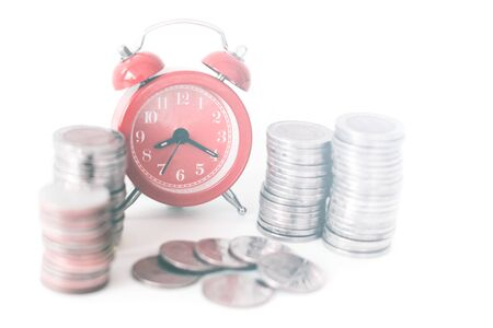 Red old fashioned alarm clock on time to work at make money. Stock Photo