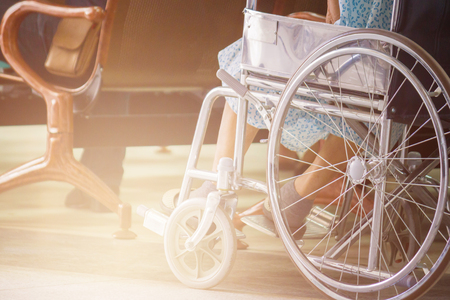 Abstract Of Woman On Wheelchair In Front Of The Outpatient Department Of Hospital With Softlight. Stock Photo