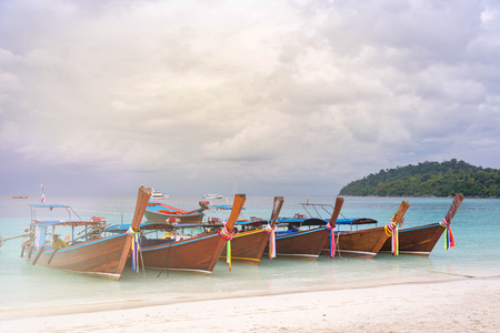 The Many Longtail Boat On Clear Blue Sea With Soft Light, Vintage Tone Stock Photo