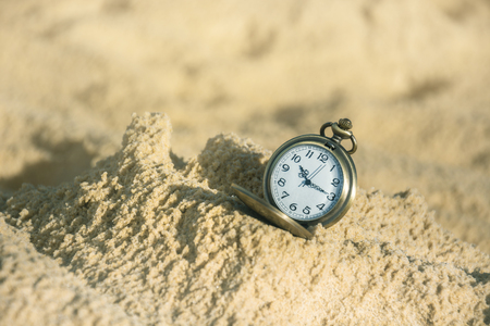 Vintage Pocket Watch On Sand With Soft Light In Morning Background. Stok Fotoğraf