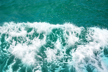 Deep Blue Sea Water Surface With White Foam And Waves Pattern, Background Photo Texture