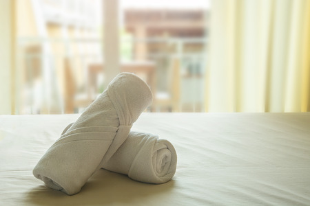 White Towel Roll Cream Rolls On Yellow Cotton Mattresses With Soft Light In Morning. Stok Fotoğraf