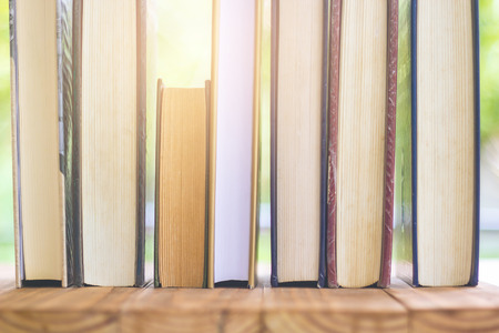 Stack Of Thick Books With Beautiful Light And Bokeh Background.