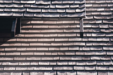 Wood Shingle Roof In Poor Repair, Traditional Wooden Roof Tile Of Old House, Susceptible To Fire And Costly