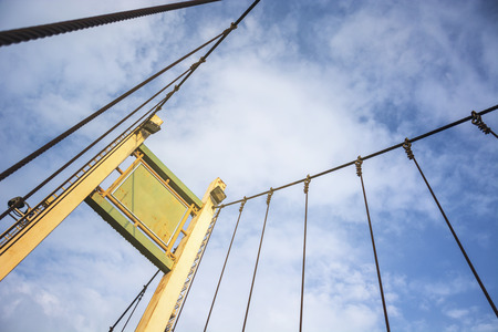 Structure Of Concrete Poles And Wire Rope Hanger Bridge Mount, And Clear Blue Sky.