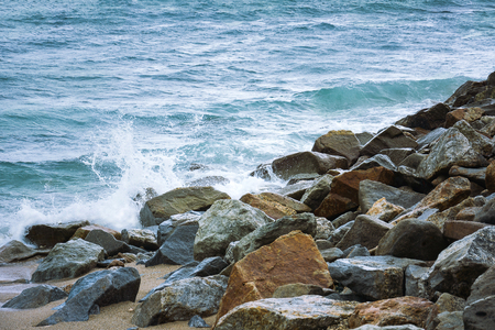 Stone In Green Sea With Wave