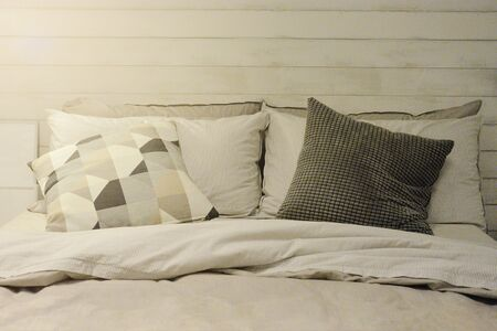 Pillow And Blanket On Bed In Vintage Wooden Bedroom With Lighting Upper Left Side.