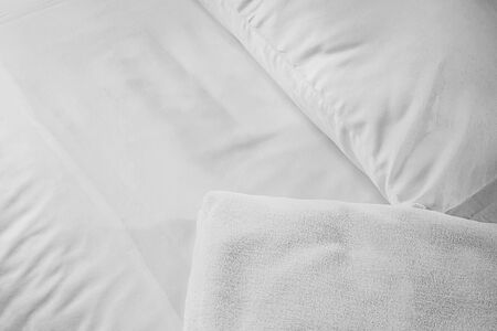 white towel on white mattress fabric, soft light in the morning