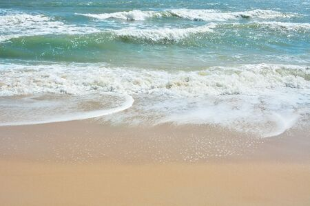 Wave of the sea on the sand beach, Beach and tropical sea, Paradise idyllic beach, Summer holidays, Ocean in the evening as nature travel background.