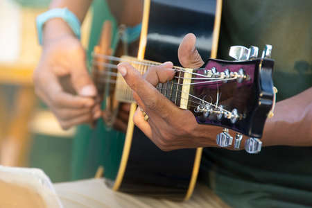Closeup Of Man's Hand Playing Acoustic Guitar, Soft Vintage Style. Stock Photo