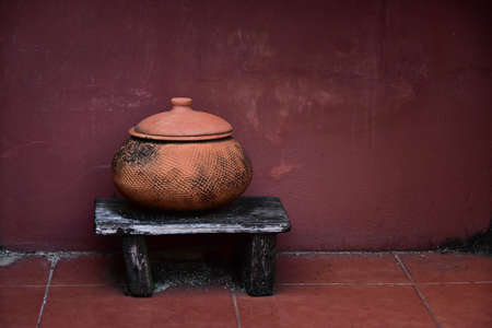 Old Earthenware Clay Pot On Old Wall For Background.