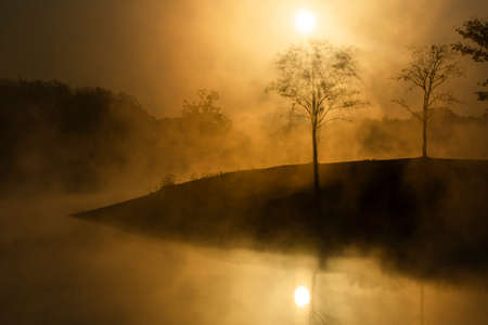 Early Foggy Morning On The Lake In Spring Morning.