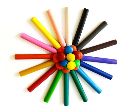 oil pastel crayons with colorful candies Stock Photo - 10493410