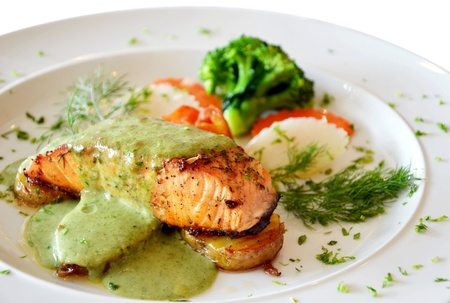 steak dinner: roasted salmon served with green sauce  Stock Photo