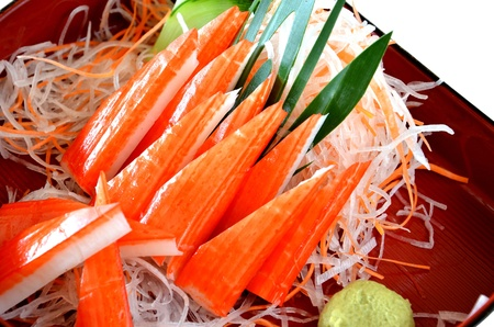 Crabmeat sticks with fresh vegetables photo