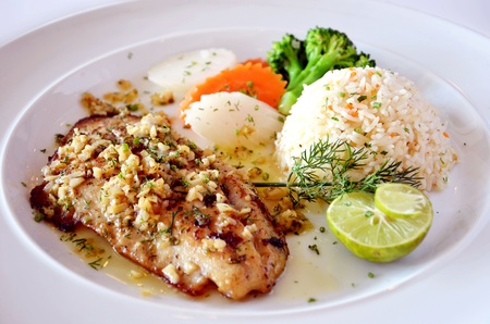 roasted fish served with fried rice Stock Photo - 11010020